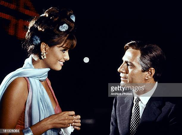 Claudia Cardinale approaches Marcello Mastroianni in a scene from the film '8½', 1963.