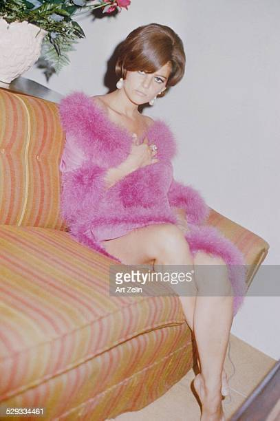 Claudia Cardinale at the Drake Hotel wearing a pink feather trimmed negligee circa 1970 New York