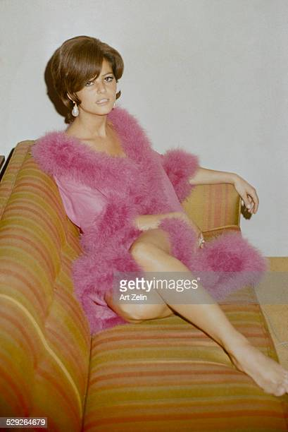 Claudia Cardinale in a feather trimmed negligee; circa 1970; New York.