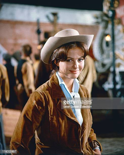 Claudia Cardinale, Italian actress, in costume, wearing a corduroy jacket and hat, in a publicity portraitr issued for the film, 'The Magnificent...