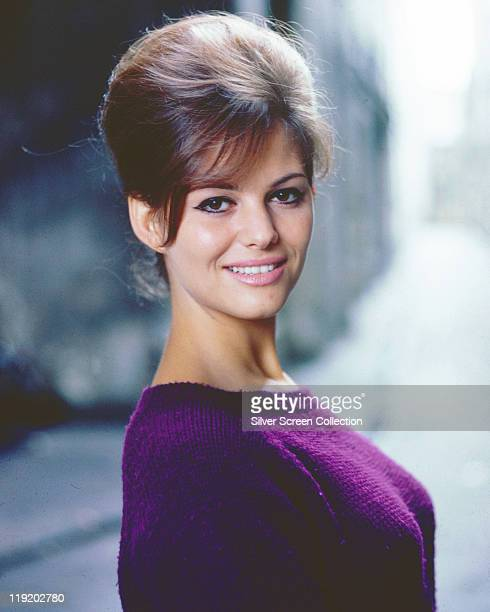 Claudia Cardinale, Italian actress, with a beehive hairstyle, wearing a purple jumper, circa 1960.