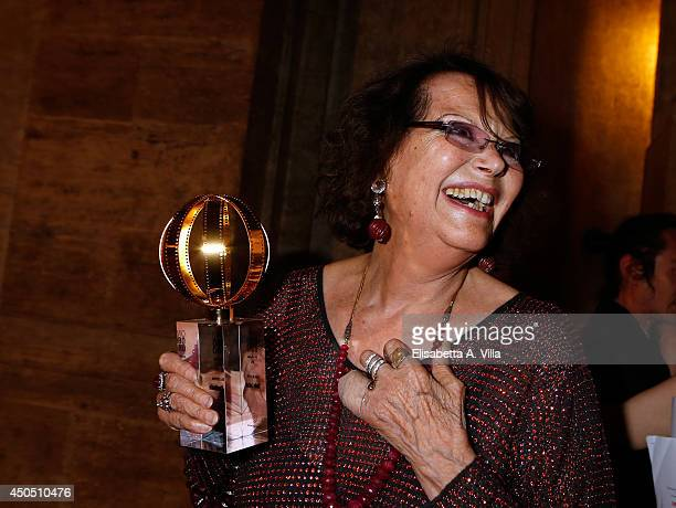 Claudia Cardinale poses with the award at the carreer as she attends the Globi D'Oro Awards Ceremony at the French Embassy Palazzo Farnese on June 12...