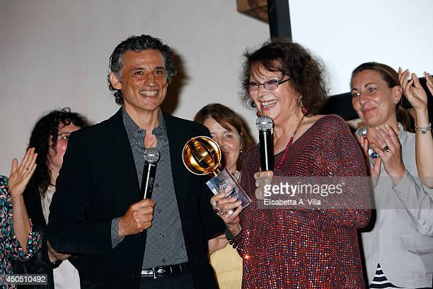 Claudia Cardinale receives the award at the carreer from actor Enrico Lo Verso as she attends the Globi D'Oro Awards Ceremony at the French Embassy...