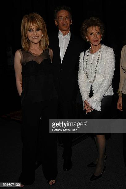 Claudia Cohen Calvin Klein and Lily Safra attend The Irvington Institute for Immunological Research Through The Kitchen Benefit Dinner at The Four...