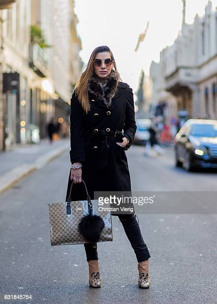 Claudia Corradiono wearing Gucci sneak leather shoes a black Dolce Gabbana coat Gucci bag Fendi accessories at Wood during Milan Men's Fashion Week...