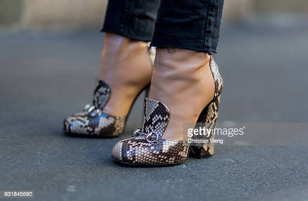 Claudia Corradiono wearing Gucci sneak leather shoes at Wood during Milan Men's Fashion Week Fall/Winter 2017/18 on January 16 2017 in Milan Italy