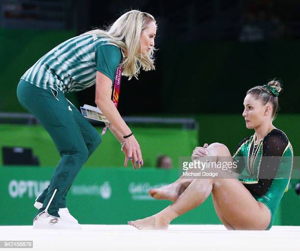 Claudia Cummins of South Africa is attended to after injuring her leg in the Floor during the Gymnastics Artistic Women's Team Final and Individual...