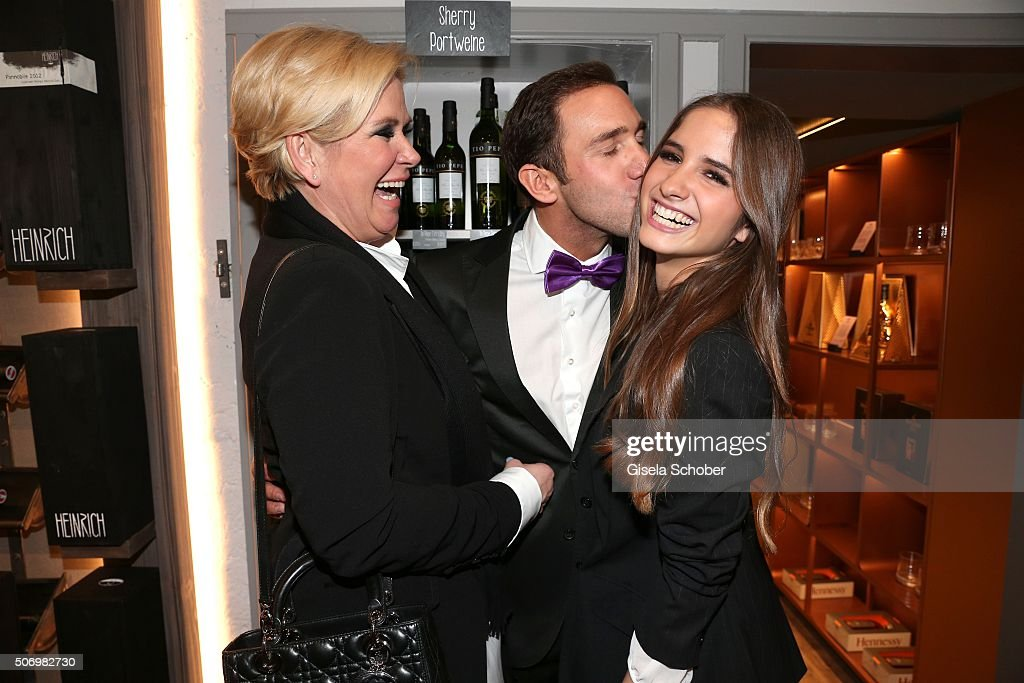 Claudia Effenberg, and her daughter Lucia Strunz and Marcel Remus (C) during the Smoking Cocktail at Kaefer Atelier on January 26, 2016 in Munich, Germany.