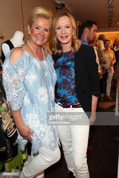 Claudia Effenberg and Katja Flint during the charity shopping night at CE design store on May 31, 2017 in Munich, Germany.