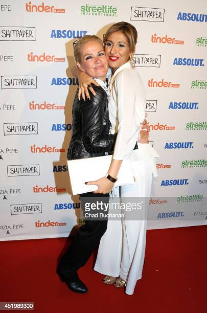 Claudia Effenberg and Senna Gammour attend the Shitpaper launch party on July 10 2014 in Berlin Germany