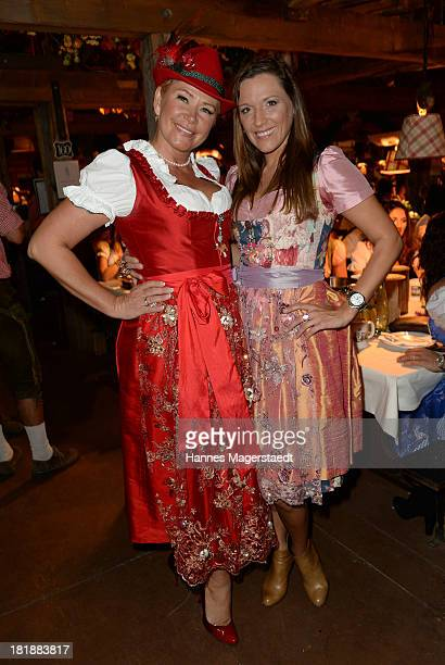 Claudia Effenberg and Simone Ballack attend the Oktoberfest beer festival at the Kaefer tent on September 25 2013 in Munich Germany