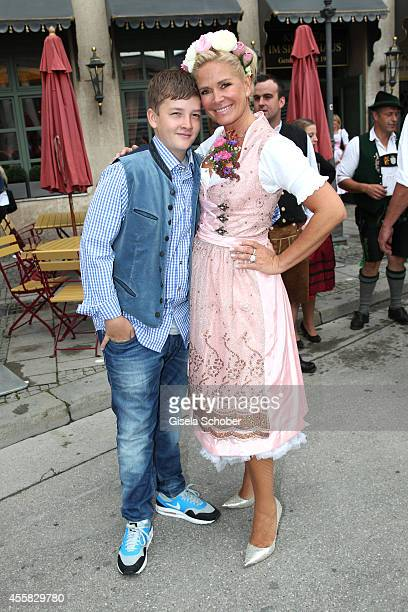Claudia Effenberg wearing a dirndl of 'Dirndl Liebe' and her son Thommy Strunz during Oktoberfest Opening Perusastrasse Start to the Oktoberfest on...