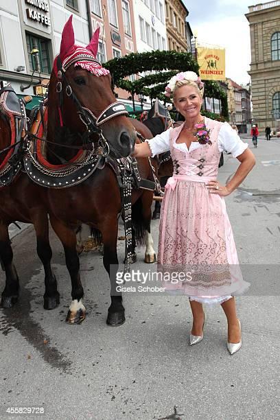 Claudia Effenberg wearing a dirndl of 'Dirndl Liebe' during Oktoberfest Opening Perusastrasse Start to the Oktoberfest on September 20 2014 in Munich...