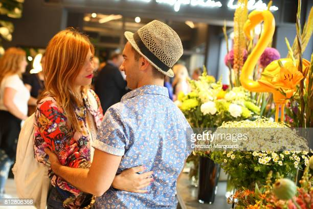 Claudia Eisinger and Kian ShamsDolatabadi attend the 'Kians Garden Flower Shop' Opening Event at Kantstrasse on July 11 2017 in Berlin Germany