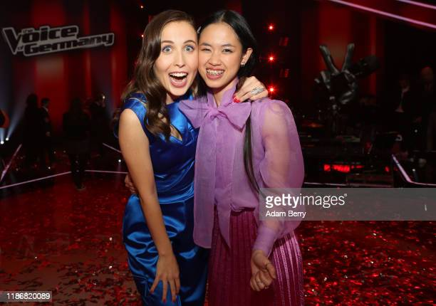 Claudia Emmanuela Santoso and Alice Merton celebrate after winning the finals of The Voice of Germany on November 10 2019 in Berlin Germany