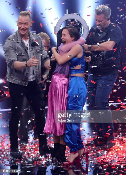 Claudia Emmanuela Santoso and Alice Merton hug each other after winning the finals of The Voice of Germany on November 10 2019 in Berlin Germany