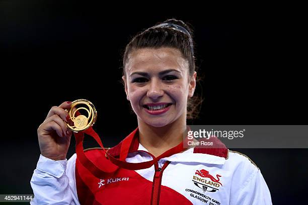 Claudia Fragapane of England celebrates on the podium after winning the Women's AllAround Final at the SECC Precinct during day seven of the Glasgow...