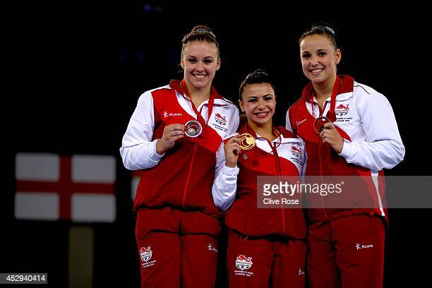 Claudia Fragapane of England poses on the podium with Ruby Harrold and Hannah Whelan of England after winning the Women's AllAround Final at the SECC...