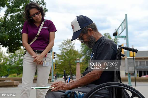 Claudia FreyGrant talks with Henry Marsh as he updates his voter registration at Martin Luther King Jr Library in Aurora Colorado on August 23 2016...