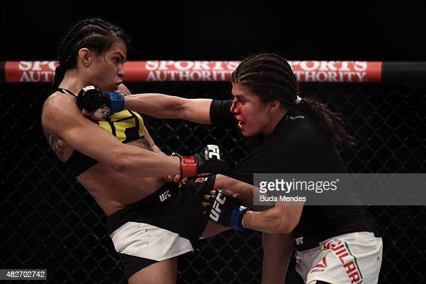 Claudia Gadelha of Brazil and Jessica Aguilar of the United States exchange punches in their strawweight bout during the UFC 190 Rousey v Correia at...
