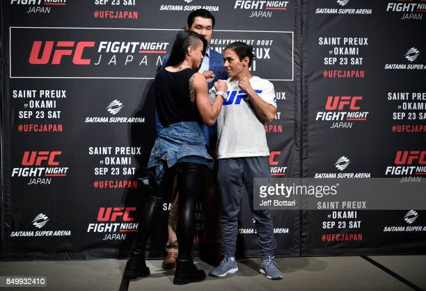 Claudia Gadelha of Brazil and Jessica Andrade of Brazil face off for the media during the UFC Ultimate Media Day at the Park Hyatt on September 20...