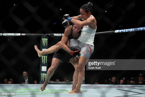 Claudia Gadelha of Brazil attempts to take down Carla Esparza in the second round in their strawweight bout during the UFC 225 Whittaker v Romero 2...