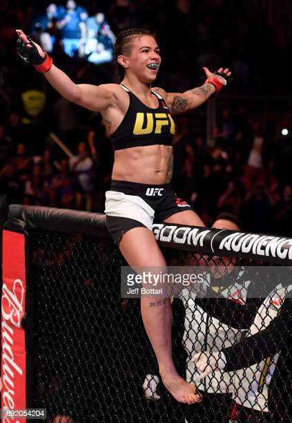 Claudia Gadelha of Brazil celebrates after her submission victory over Karolina Kowalkiewicz of Poland in their womens strawweight bout during the...