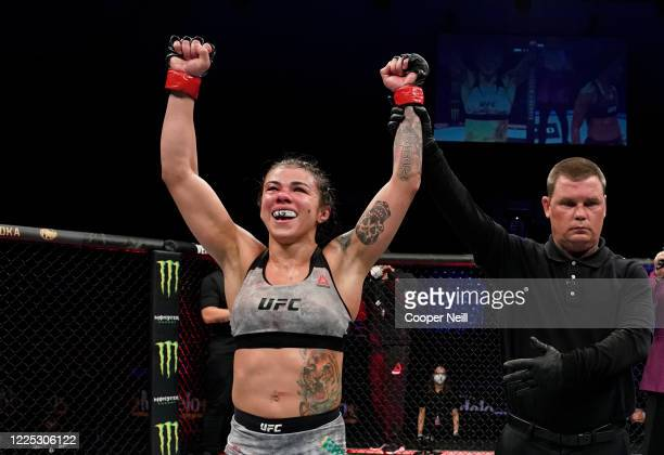 Claudia Gadelha of Brazil celebrates after her victory over Angela Hill in their strawweight fight during the UFC Fight Night event at VyStar...