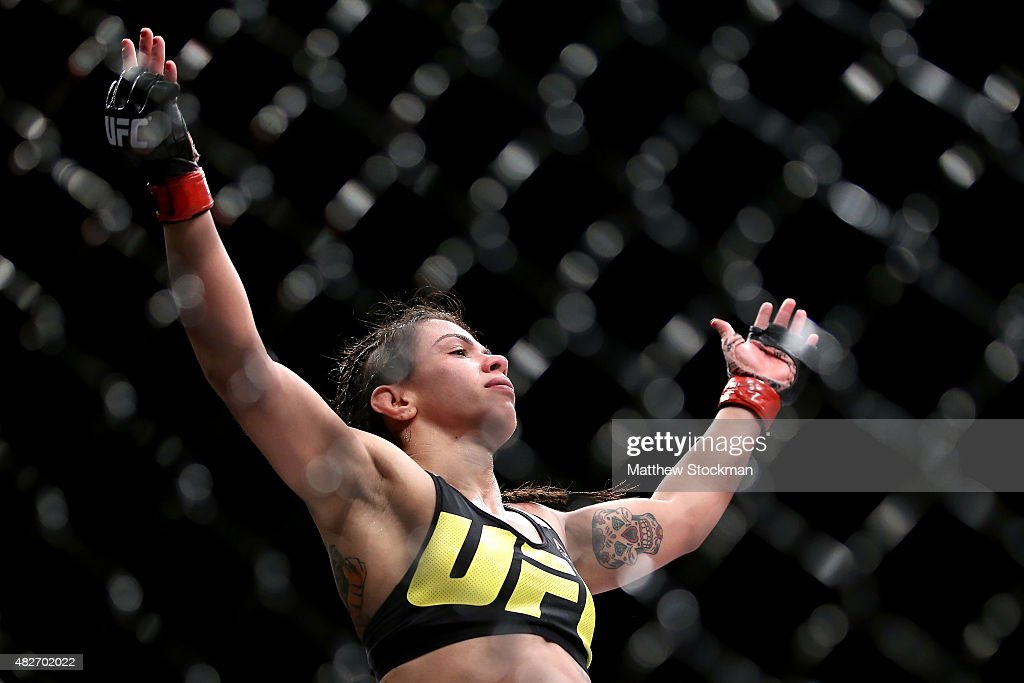 Claudia Gadelha of Brazil celebrates her win overJessica Aguilar of the United States in their strawweight bout during the UFC 190 Rousey v Correia at HSBC Arena on August 1, 2015 in Rio de Janeiro, Brazil.