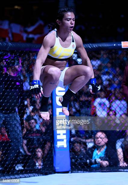 Claudia Gadelha of Brazil enters the Octagon before her women's strawweight championship bout against Joanna Jedrzejczyk during The Ultimate Fighter...