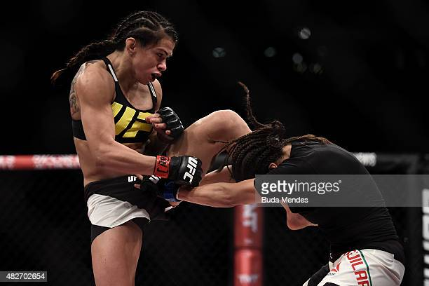 Claudia Gadelha of Brazil kicks Jessica Aguilar of the United States in their strawweight bout during the UFC 190 Rousey v Correia at HSBC Arena on...