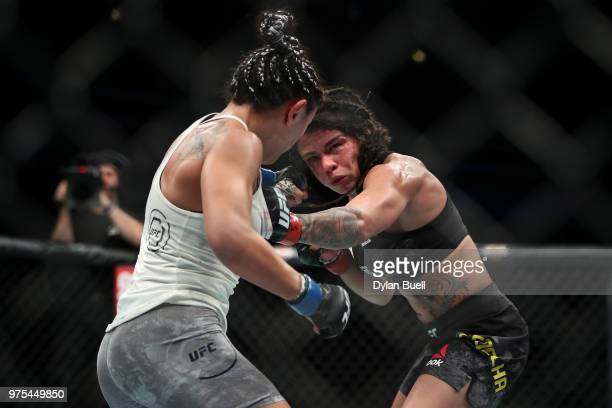 Claudia Gadelha of Brazil lands a punch against Carla Esparza in the third round in their strawweight bout during the UFC 225 Whittaker v Romero 2...