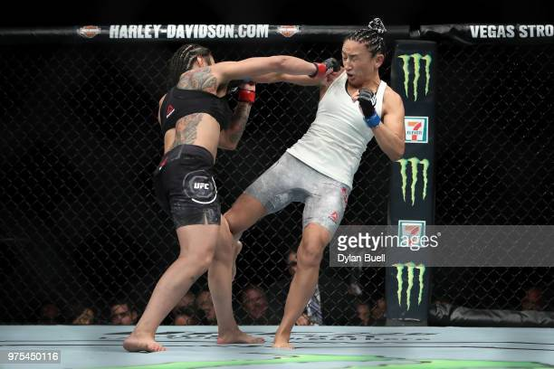 Claudia Gadelha of Brazil lands a punch against Carla Esparza in the second round in their strawweight bout during the UFC 225 Whittaker v Romero 2...