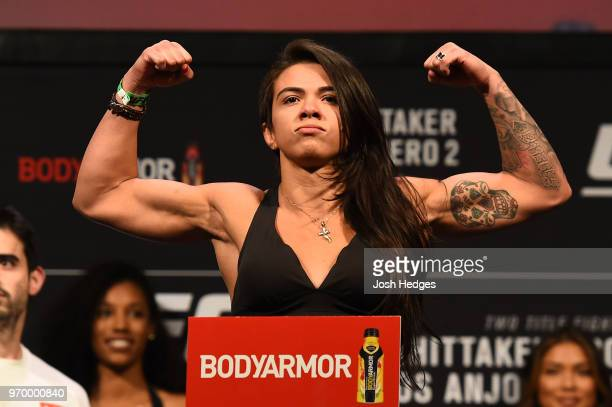 Claudia Gadelha of Brazil poses on the scale during the UFC 225 weighin at the United Center on June 8 2018 in Chicago Illinois
