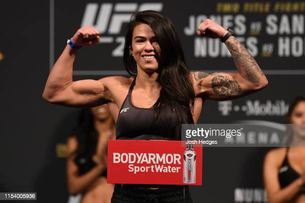 Claudia Gadelha of Brazil poses on the scale during the UFC 235 weighin at TMobile Arena on July 5 2019 in Las Vegas Nevada