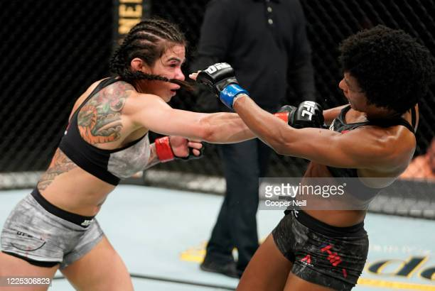 Claudia Gadelha of Brazil punches Angela Hill in their strawweight fight during the UFC Fight Night event at VyStar Veterans Memorial Arena on May 16...