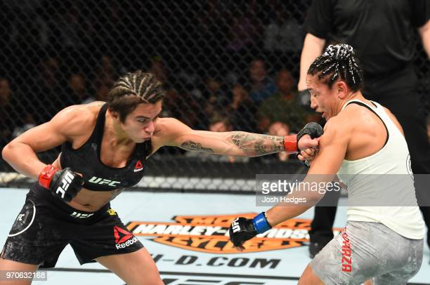 Claudia Gadelha of Brazil punches Carla Esparza in their women's strawweight fight during the UFC 225 event at the United Center on June 9 2018 in...