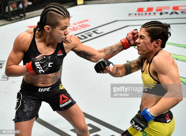 Claudia Gadelha of Brazil punches Jessica Andrade of Brazil in their women's strawweight bout during the UFC Fight Night event inside the Saitama...