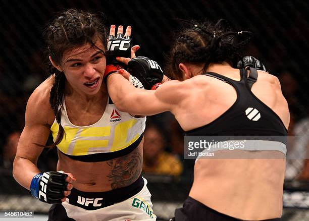 Claudia Gadelha of Brazil punches Joanna Jedrzejczyk of Poland in their women's strawweight championship bout during The Ultimate Fighter Finale...