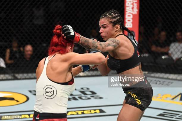 Claudia Gadelha of Brazil punches Randa Markos of Canada in their strawweight fight during the UFC 239 event at TMobile Arena on July 6 2019 in Las...