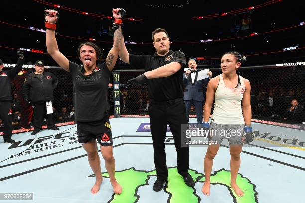 Claudia Gadelha of Brazil reacts after defeating Carla Esparza in their women's strawweight fight during the UFC 225 event at the United Center on...