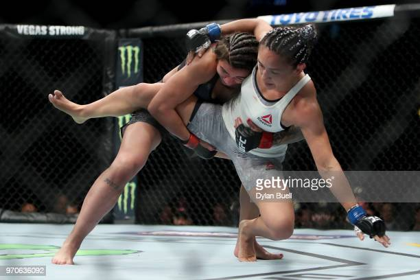 Claudia Gadelha of Brazil takes down Carla Esparza in the first round in the second round in their strawweight bout during the UFC 225 Whittaker v...