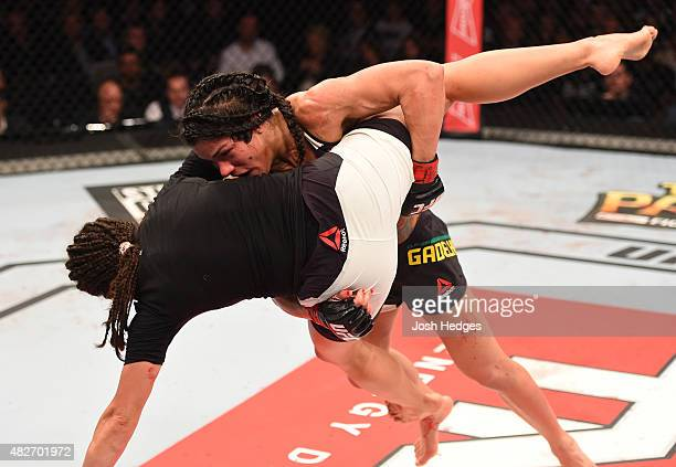 Claudia Gadelha of Brazil takes down Jessica Aguilar of the United States in their women's strawweight bout during the UFC 190 event inside HSBC...