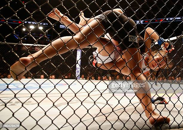 Claudia Gadelha takes down Joanna Jedrzejczyk in their women's strawweight bout during the UFC Fight Night event at the at US Airways Center on...