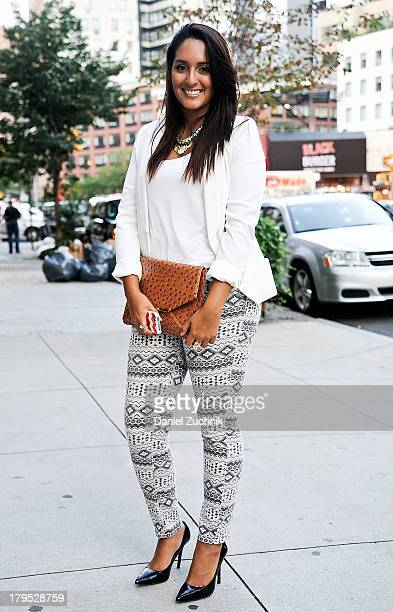 Claudia Garcia is seen outside the Pamela Gonzales presentation wearing Charlotte Russe pants HM blazer BCBG heels and an HM necklace on September 4...