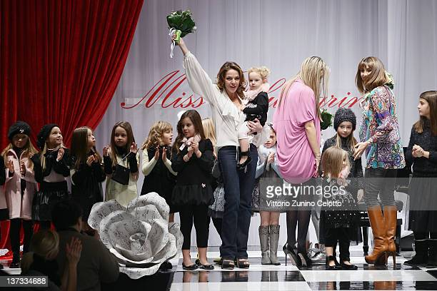 Claudia Gerini Alice Gilardino and Benedetta Parodi acknowledge the applause of the public after the Miss Blumarine fashion show as part of Pitti...
