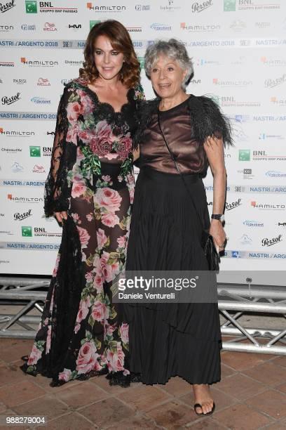 Claudia Gerini and Erminia Ferrari Manfredi attends the Nastri D'Argento cocktail party on June 30 2018 in Taormina Italy