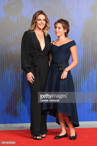 Claudia Gerini and Rosa Enginoli walk the red carpet ahead of the 'Suburra La Serie' screening during the 74th Venice Film Festival at Sala Giardino...