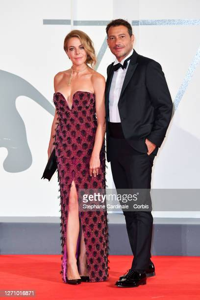 Claudia Gerini and Simon Clementi walk the red carpet ahead of the movie The World To Come at the 77th Venice Film Festival on September 06 2020 in...