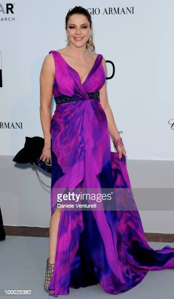 Claudia Gerini arrives at amfAR's Cinema Against AIDS 2010 benefit gala at the Hotel du Cap on May 20 2010 in Antibes France